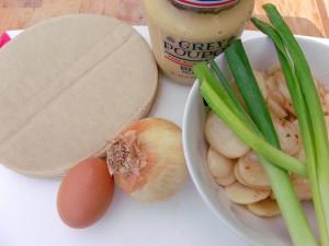 potato salad, scallions, whole egg, onion, pre-made turnover dough sheets