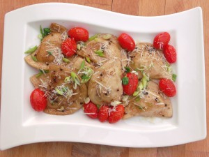 Potato And Onion Pierogi With Grape Tomatoes And Cracked Black Pepper  In Beurre Noisette