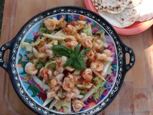 top the salad with the shrimp and its juices; serves 2 main courses or 6 appetizers