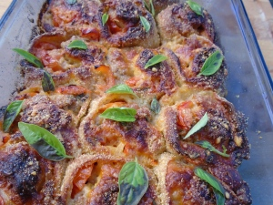 bake in a 375F oven until cooked through and a nice crust has formed, remove from heat, let cool down to room temperature, sprinkle with fresh basil leaves