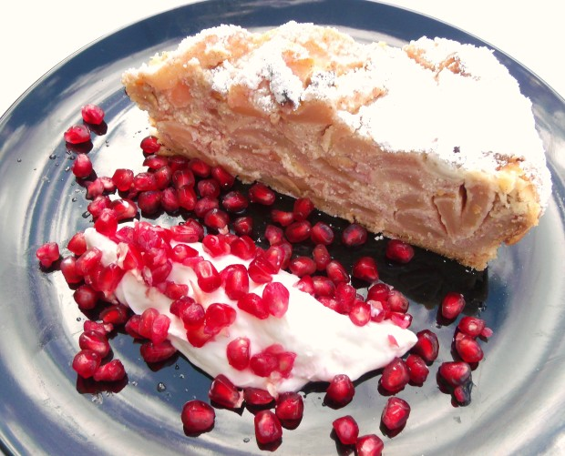 Ricotta Cheese Cake With Apples And Cashews, Served With Greek Yogurt And Pomegranate Seeds