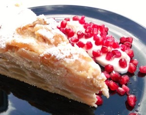 Ricotta Cheese Cake With Apples And Cashews. Served With GreekYogurt And Pomegranate