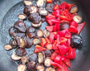 saute 8 oz of reconstituted shiitake mushrooms and 1 large red pepper, cut into triangles, in 3 tblsp of peanut oil for 2 minutes, season with 1 tblsp garlic paste, 1/2 tsp grated ginger, 1 tblsp hoisin sauce, 1 tblsp soy sauce and kosher salt to taste