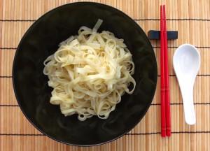 place some noodles into bowl