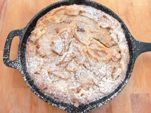 to transfer to a serving dish, turn the cake/pie upside down on a plate, then turn upside down again onto a serving dish; serve with Greek yogurt and pomegranate seeds (optional)