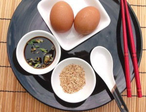 prepare per person 2 egg yolks or 1 whole egg, 2 tblsp soy sauce with 1 tblsp sliced scallion, 1 tblsp toasted sesame seeds, 1 bowl fresh-steamed rice