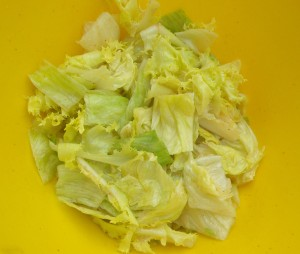 mix 2/3 of the dressing with the pear, basil and endive,
