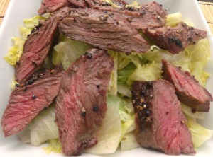 top with the sliced steak, then with the shiitake, garlic and scallions; serves 2 entrees, 4 snacks or 6 appetizers