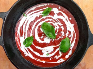 spread 2 cup tomato sauce and 1 cup heavy cream over bottom of a baking dish or cast iron pan, add some fresh basil