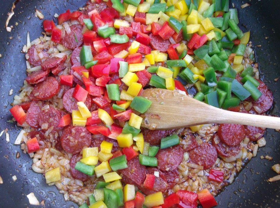 when the onions are translucent, add 1 cup diced bell peppers, saute 1 minute