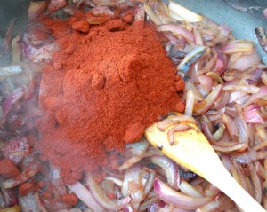 add 1 cup sweet paprika pwd, 1/2 tblsp chopped caraway seeds and 2 tblsp garlic paste