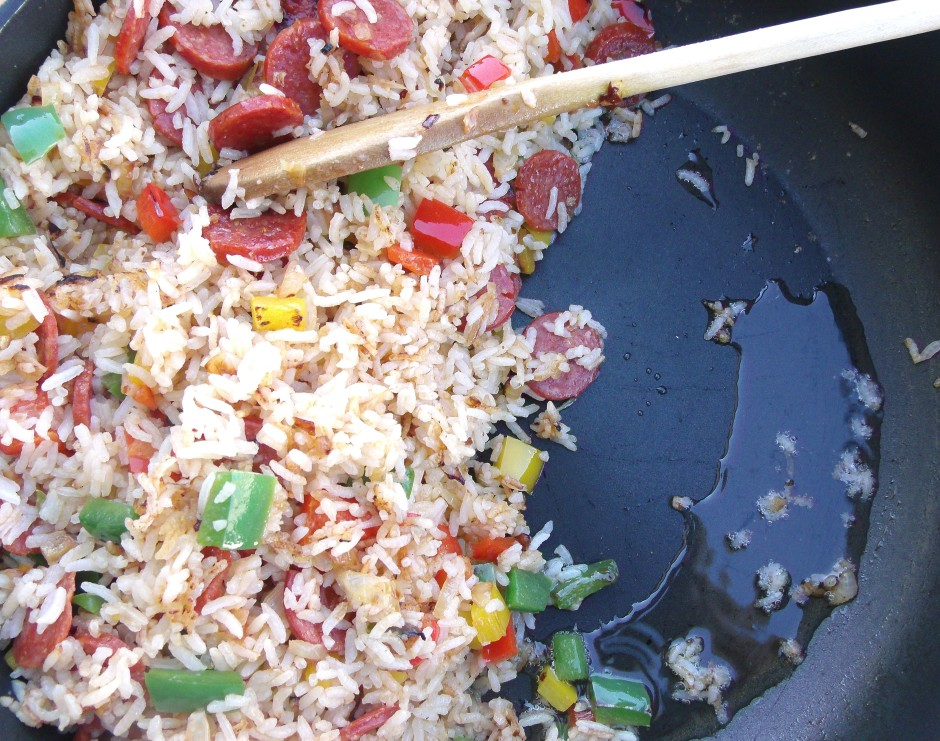 """saute until the rice """"pops"""", move the rice to one side of the pan, add two more tblsp olive oil, scramble 4 whisked eggs until set"""