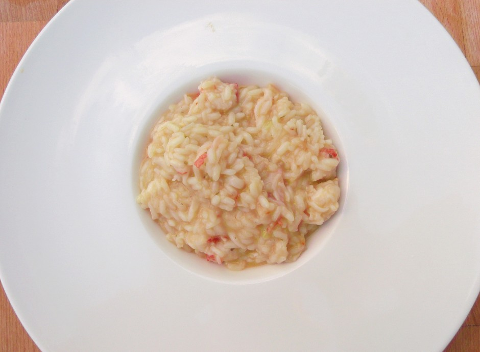 divide the risotto into 4 serving plates, top with the remaining kani kama and some more sliced scallions; serves 4