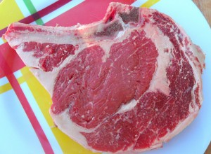 season bone-in rib eye with kosher salt and cayenne pepper, grill to your preferred internal temperature