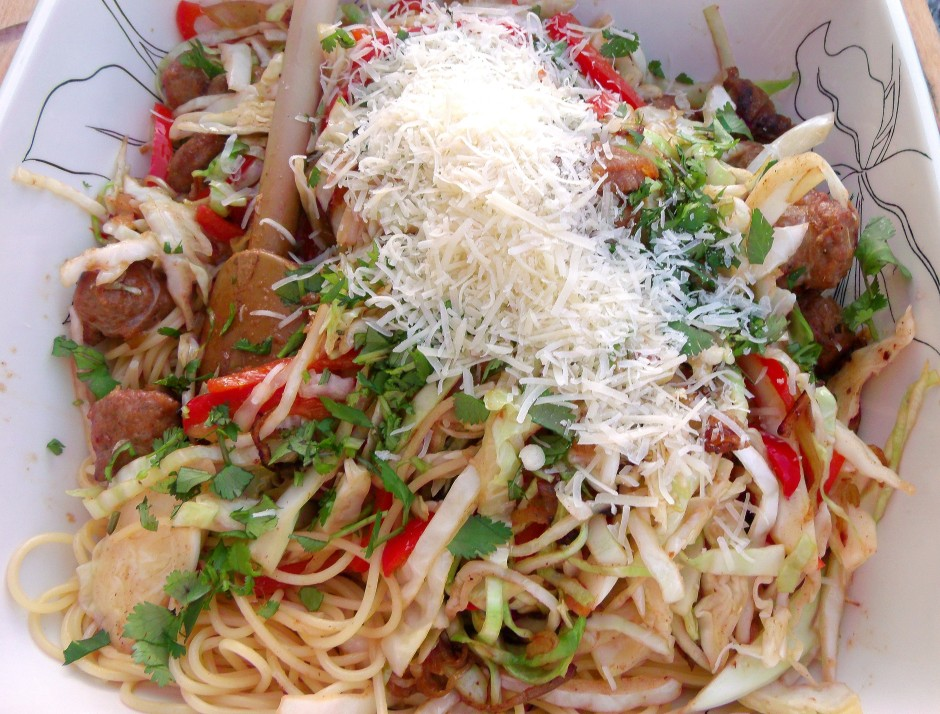 top the spaghetti with the sauteed sausage and veggies, add 3 tblsp fresh-grated asiago cheese and 3 tblsp chopped Italian parsley