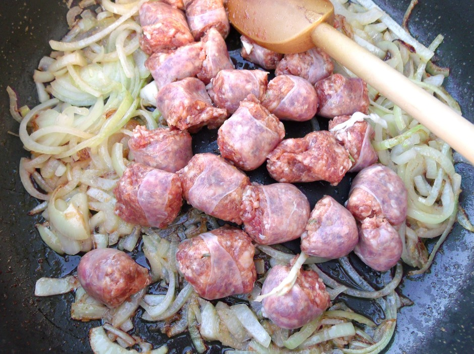 saute julienne of 2 med.size onions, 1 tblsp garlic paste and 5 ea spicy Italian sausages in 2 tblsp olive oil