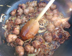 saute until the onions are lightly caramelized and the sausages are cooked through