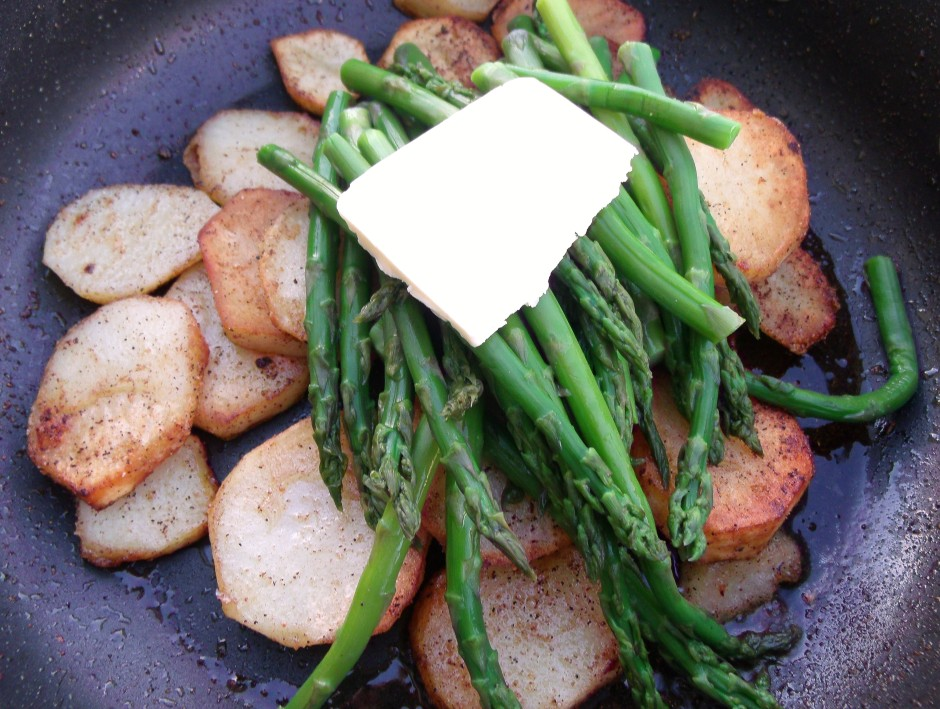 when potatoes are golden, discarg the oil, add the asparagus and 2 oz whole butter, saute until asparagus are heated through